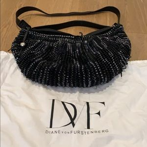 DVF hobo crossbody/shoulder/handbag. needs repair.